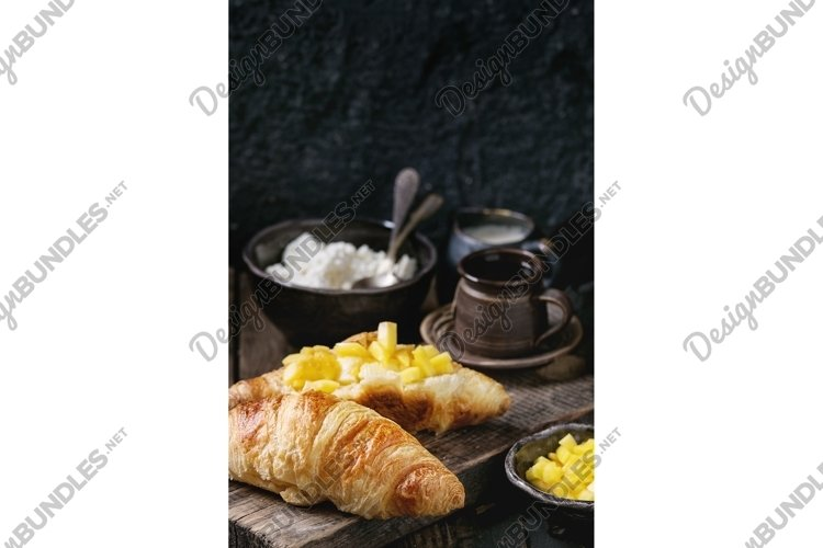 Breakfast with croissant and mango fruit example image 1