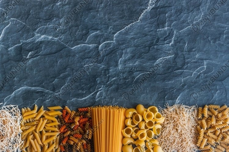Different types of pasta on a stone example image 1