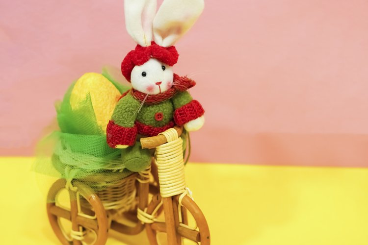 Colored easter eggs in the basket, easter rabbit example image 1