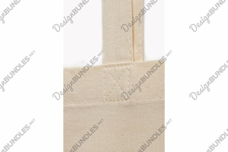 Sewing seam on the beige fabric handle of the bag example image 1