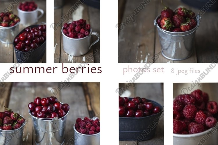 Set of summer berries in metal bowls on wooden background
