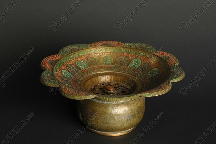 Ancient metal bowl on dark background. Bronze tableware example image 1