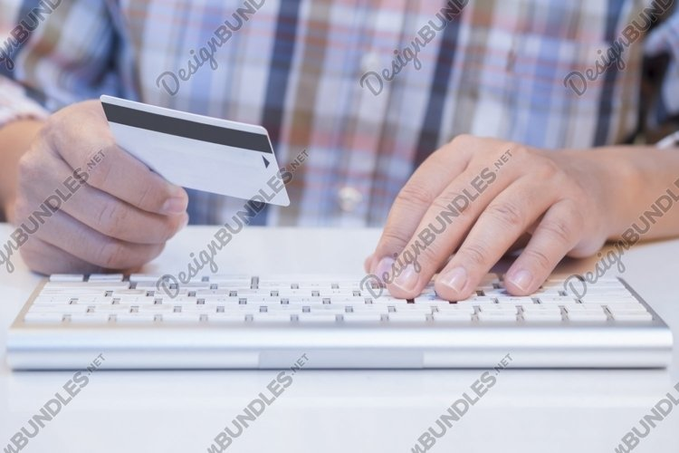 Man online shopping and pay by credit card. example image 1