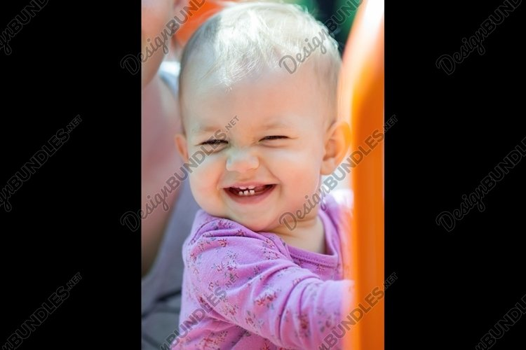 Beautiful little baby smiling example image 1