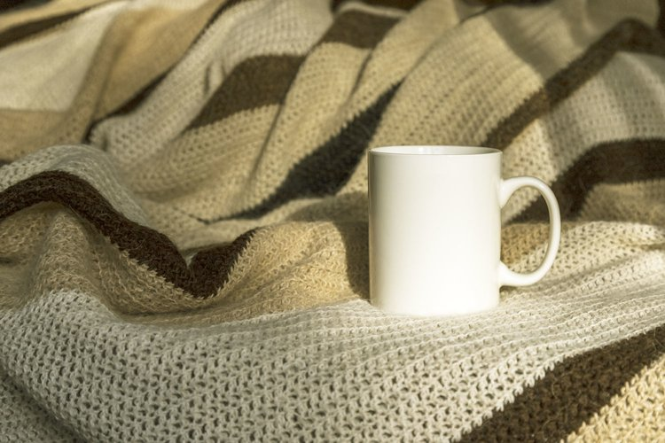 White coffee mug mockup with striped blanket. example image 1