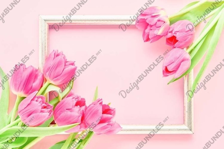 Golden frame with pink tulips on pink background. example image 1