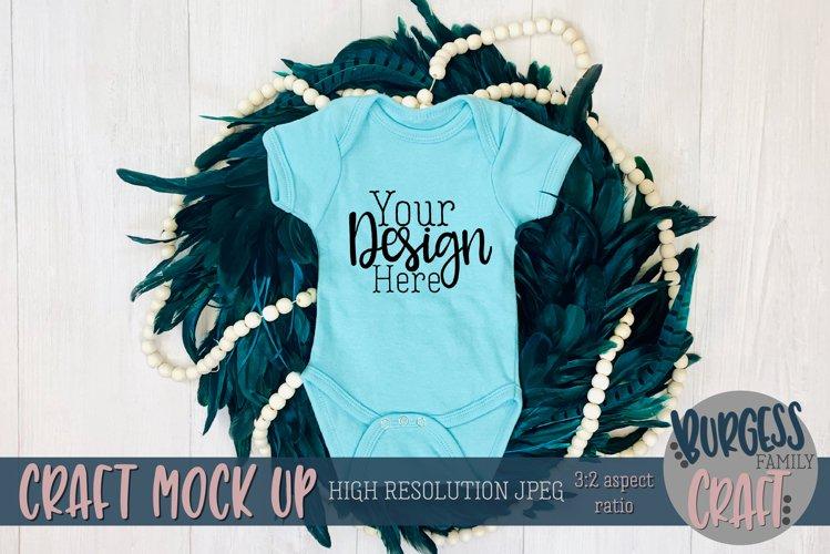 Light blue peacock baby bodysuit Craft mock up