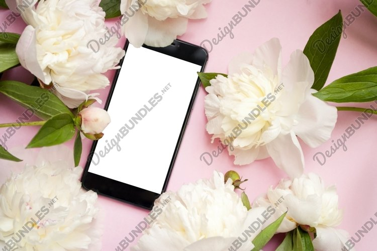 Phone and white peonies on a pink background. Mock up