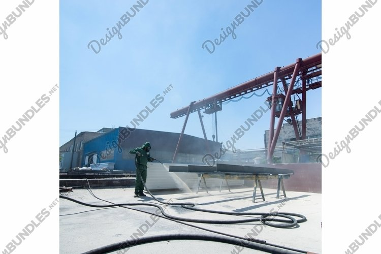 Factory for cleaning of metal by sandblasting example image 1