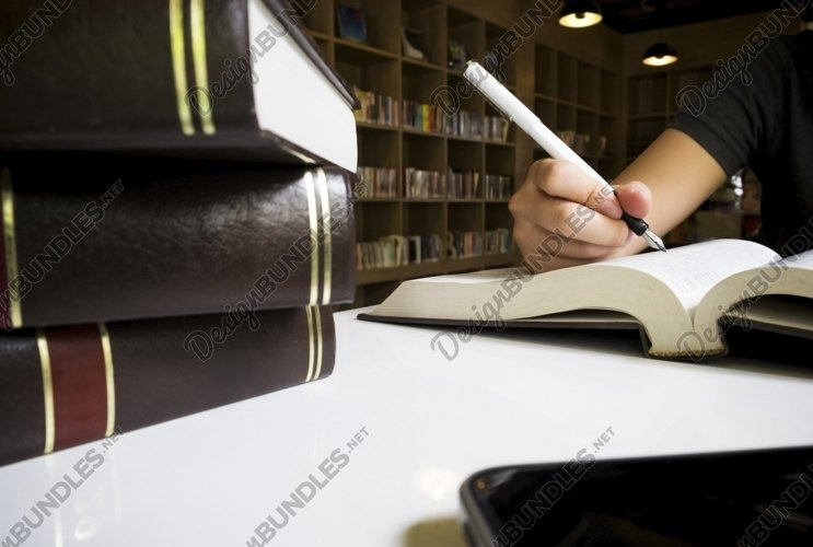 Woman reading book in library. example image 1
