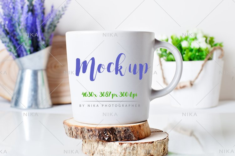 White mug on a background of flowers .