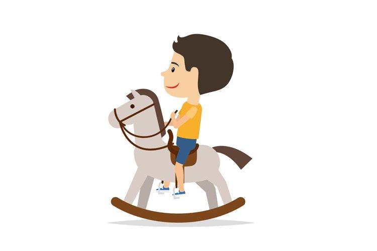 Little boy sitting on horse toy example image 1