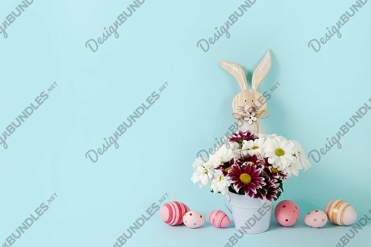 Easter spring blue background with flowers, wooden bunny example image 1