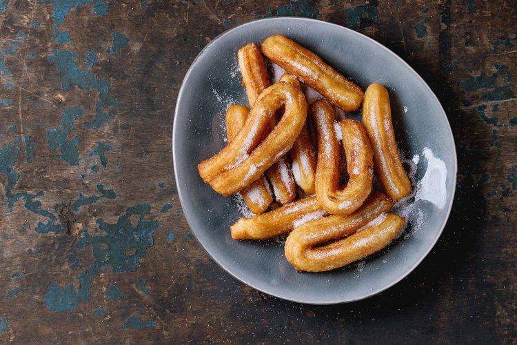 Traditional spanish churros with sugar example image 1
