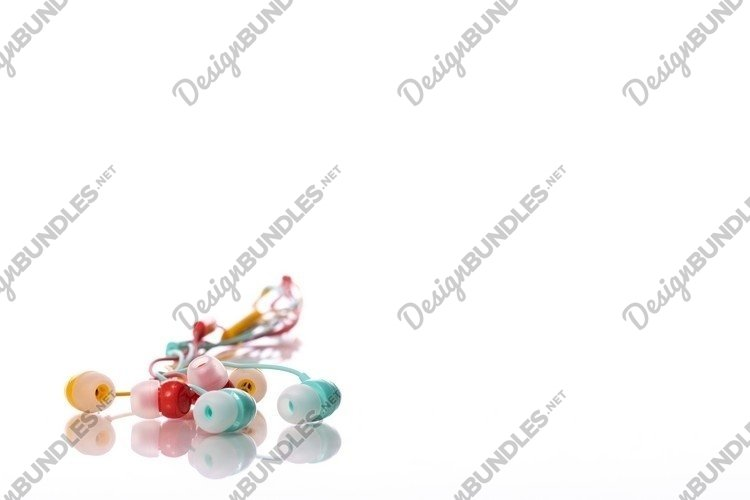 earphone reflected in glass table surface isolated on white example image 1