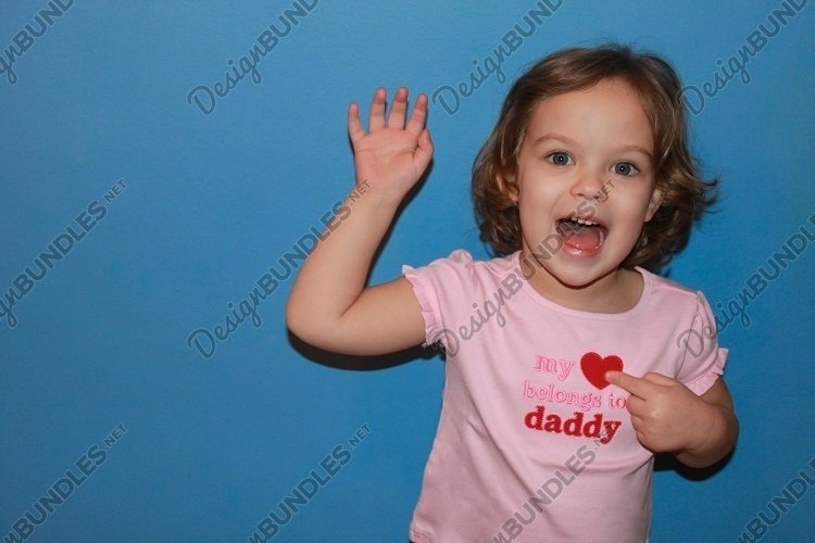 Smiling toddler girl heart symbol. Fathers Day. Copy space