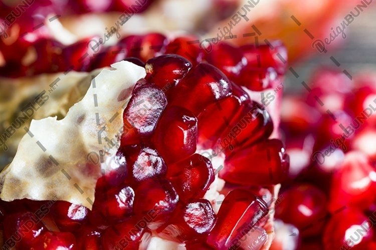 A cut red ripe pomegranate example image 1