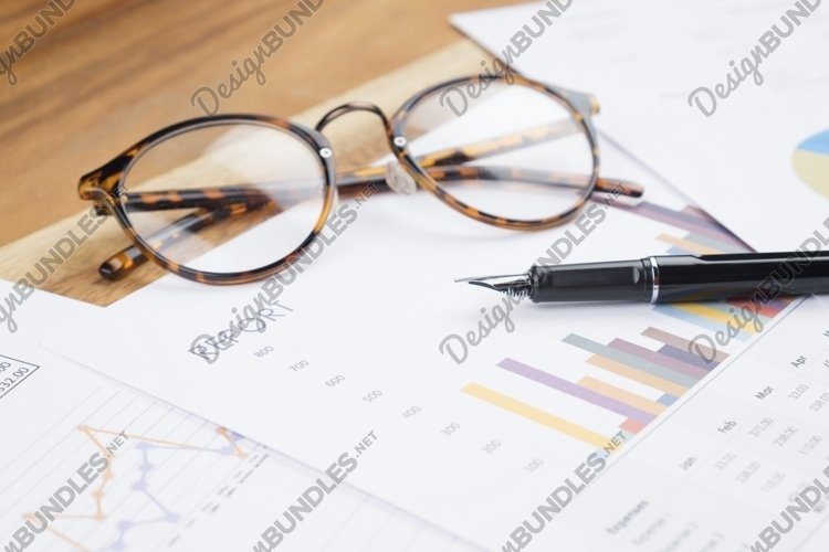 Wood working table business report analyze chart, glasses. example image 1