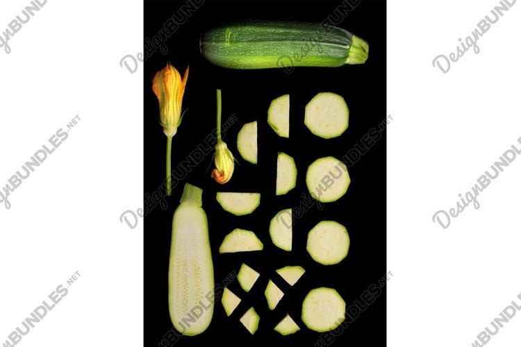 Set of green zucchini on black background example image 1
