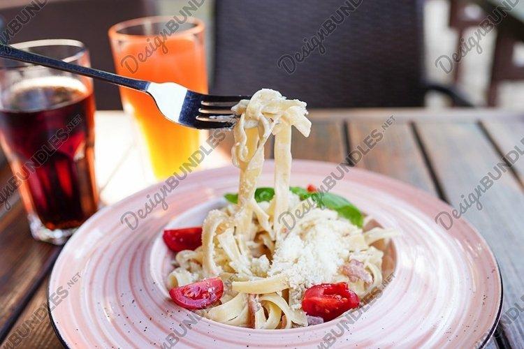 Fresh pasta with garlic Cherry Tomatoes and basil