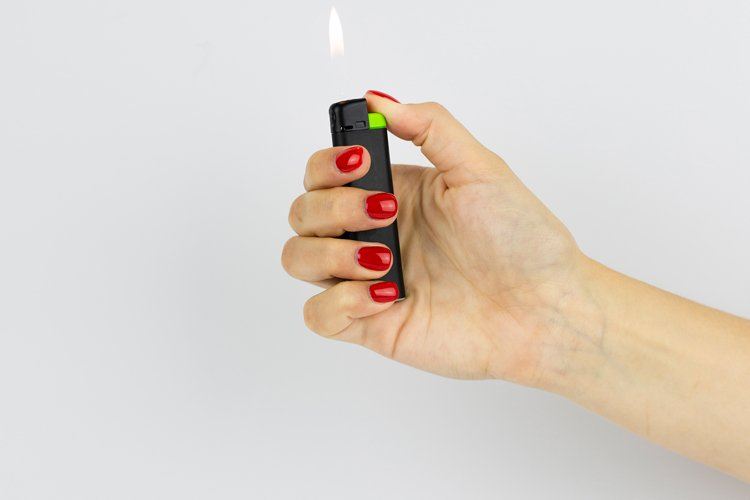 red lighter with fire in woman's hand with red nails example image 1