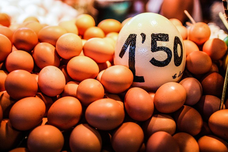 ile of eggs on the counter of Barcelona market with price example image 1