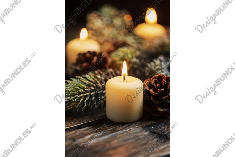 Christmas decoration with candles on over dark background example image 1