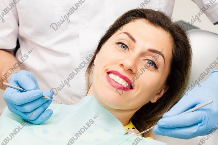 Young woman smiling at the dentist appointment. example image 1