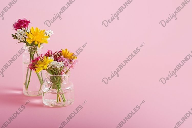 Miniature bottle with wildflowers. Greeting card template example image 1