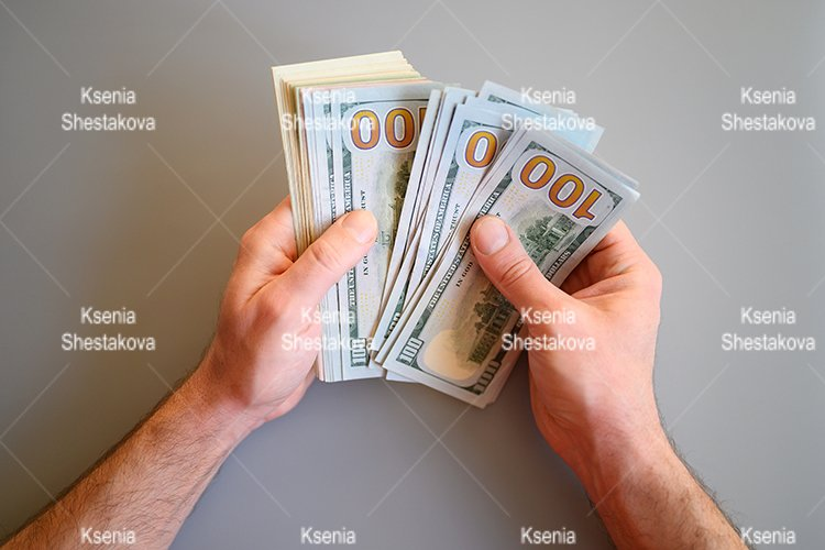pile money fan. different American dollar bills in male hand example image 1