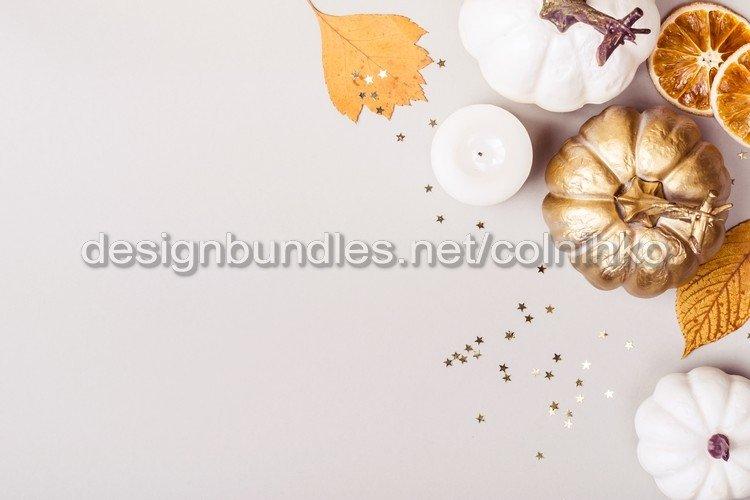 Autumn floral composition of golden pumpkins