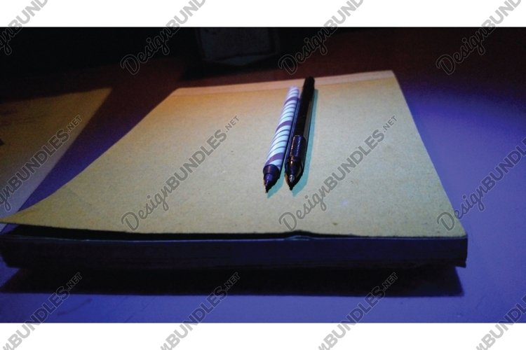 Two stationery and one book example image 1
