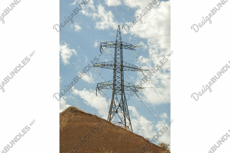High voltage tower against the blue sky with clouds example image 1