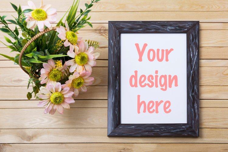 Rustic black frame mockup with pink daisies and green grass example image 1
