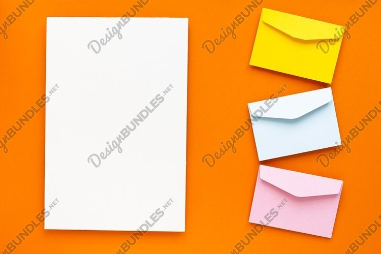 Empty blank paper and colorful envelope. example image 1
