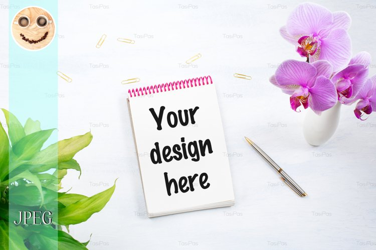 Notepad mockup with green plant and pink orchid. example image 1