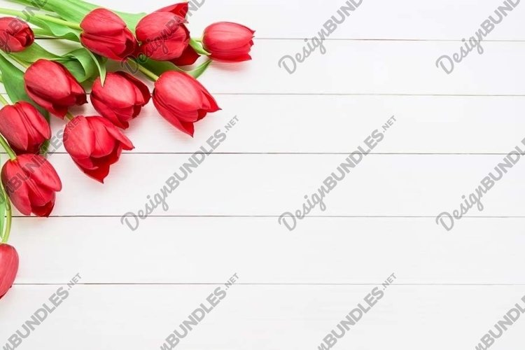 Bouquet of red tulips on white wooden background. example image 1