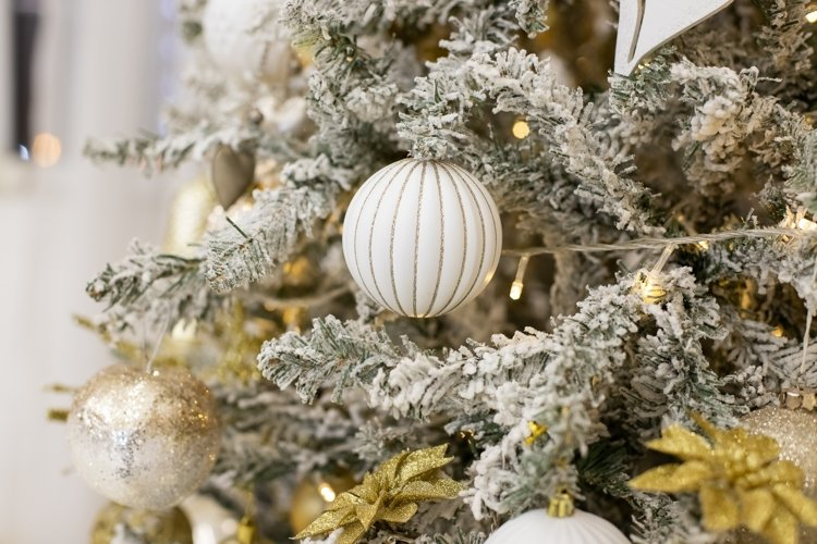 white Christmas ornaments hanging on fir tree example image 1