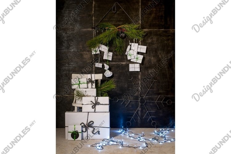 New Year and Christmas decorations, gift boxes on a black example image 1