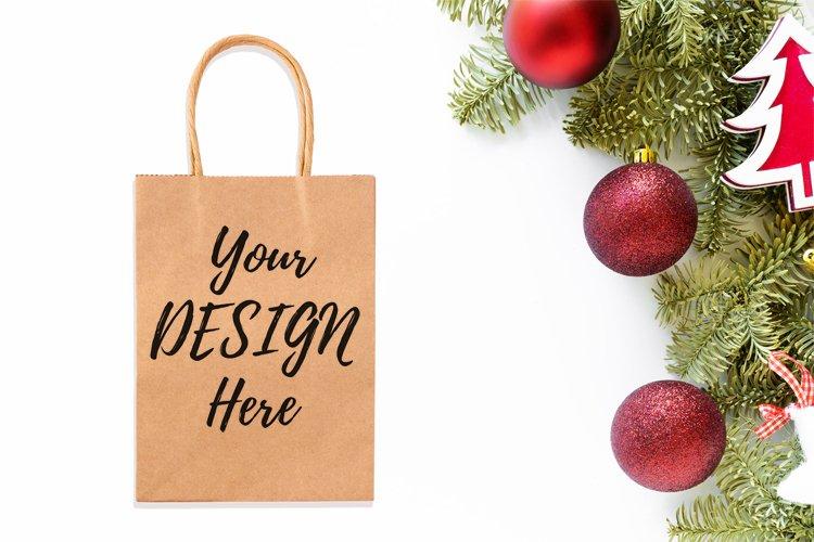 Kraft shopping bag mockup on Christmas styled background example image 1