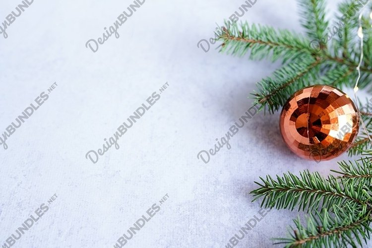 christmas background - decorations and fir branch on grey