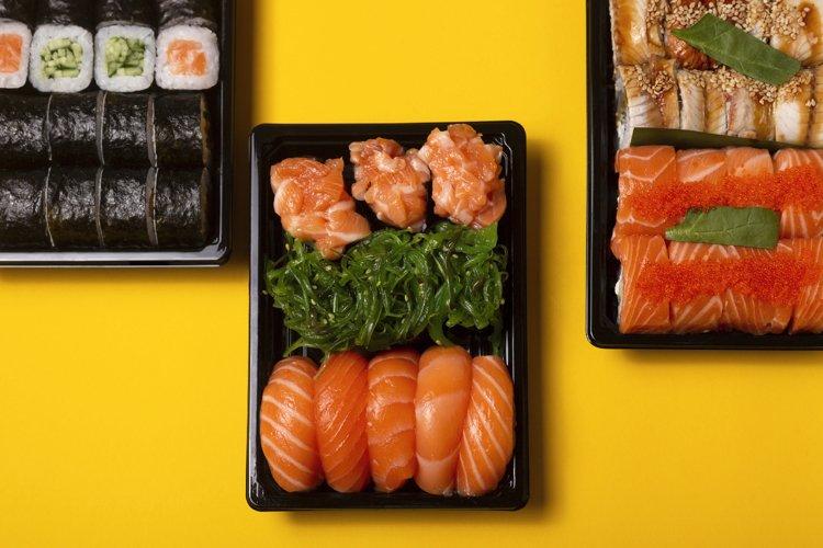 Bright beautiful sushi with fresh fish, caviar and chuka on