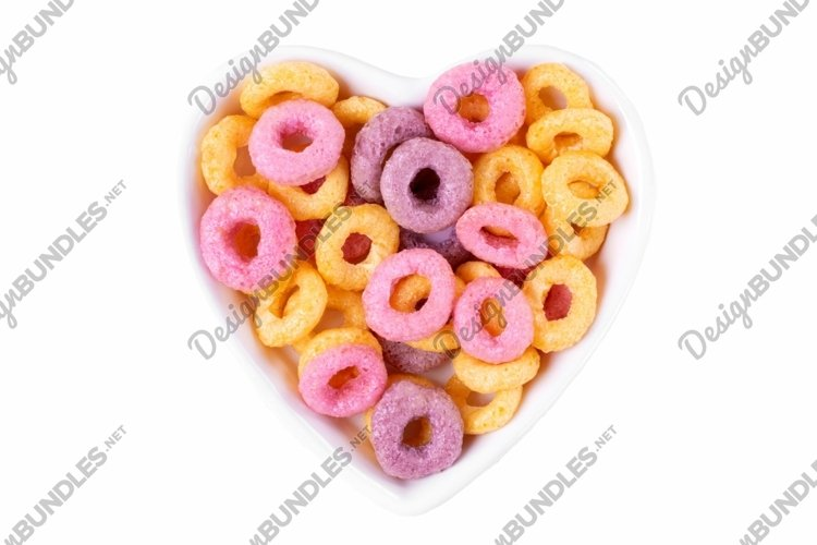 Multicolored breakfast cereal loops isolated on white