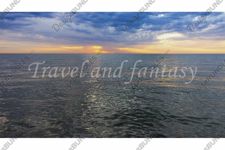 Seascape with sunset and dark sea.