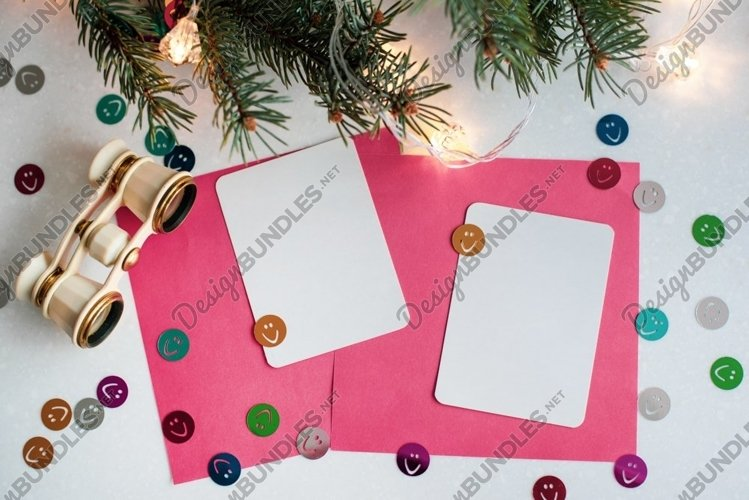 Christmas card with opera glasses, lights, copy space. example image 1