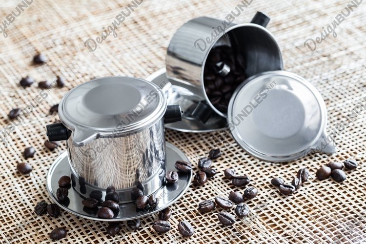 Two steel coffee makers with coffee beans on placemat. example image 1