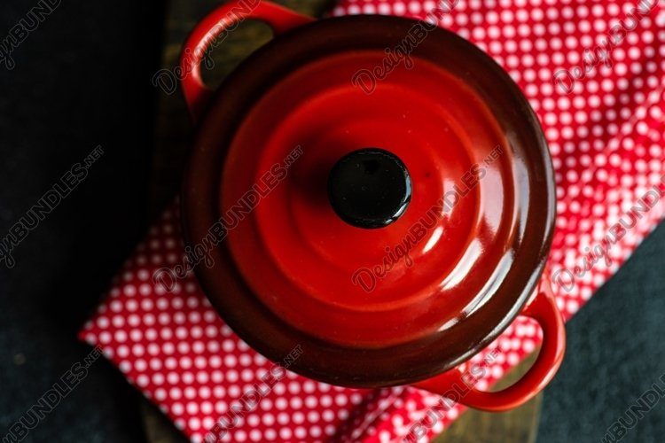 Cooking concept with ceramic pans example image 1