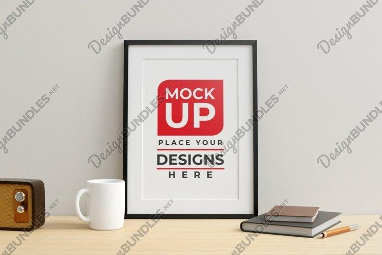 Frame mockup on work desk