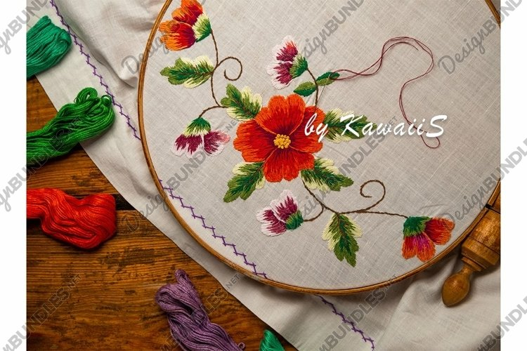 Flower embroidery on white textile in hoop wooden background example image 1
