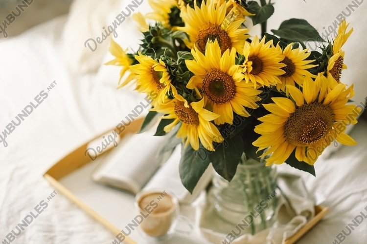 Sunflowers, Coffee and open book. Read, Rest. example image 1